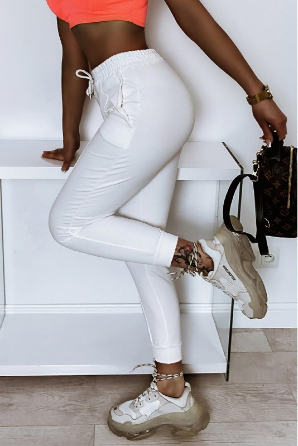 Kremowe spodnie dresowe dopasowane z przeszyciami Lyana 3