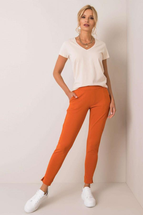 Pomarańczowe dresowe spodnie slim fit Clara