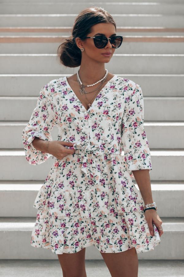 Beżowo-fioletowa sukienka kwiatowa rozkloszowana z falbankami Abella