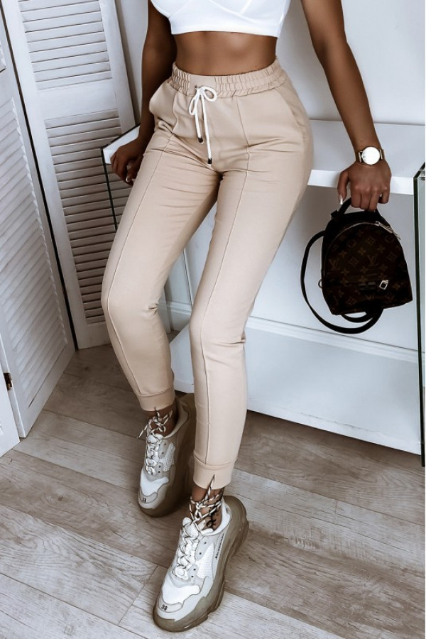 Beżowe spodnie dresowe dopasowane z przeszyciami Lyana